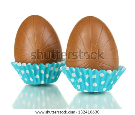 Chocolate eggs in napkin isolated on white - stock photo