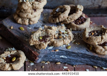 Chocolate filled cookies made of different healthy flours with seeds and nuts. Dark photo. Selective focus. Also available in vertical format. - stock photo