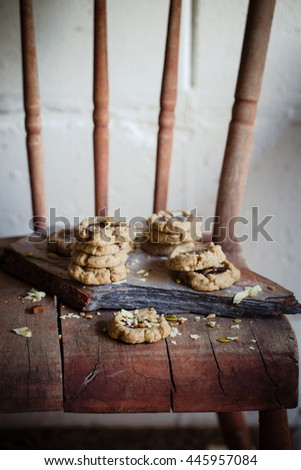Chocolate filled cookies made of healthy flours  with seeds and nuts. Dark photo. Selective focus. Also available in horizontal format. - stock photo