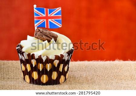 Chocolate flake cupcake with Union jack flag. - stock photo