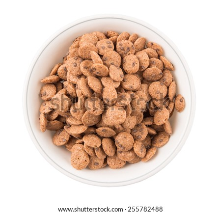 Chocolate flavored breakfast cereal in a white bowl over white background - stock photo
