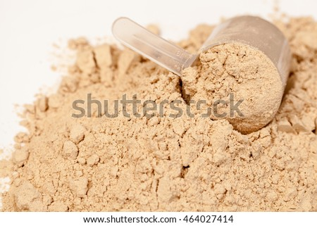 Chocolate flavoured protein whey powder with scoop