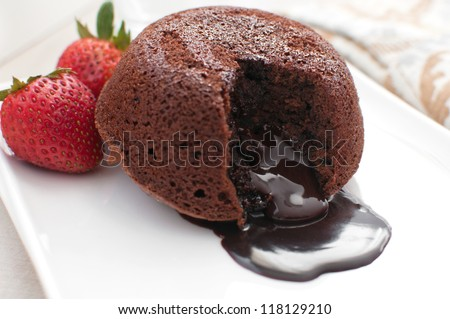 Chocolate fondant lava cake with strawberries - stock photo