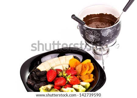 Chocolate fondue with fruits isolated on white background - stock photo