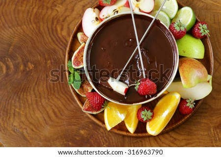 chocolate fondue with various fruits - easy and delicious dessert