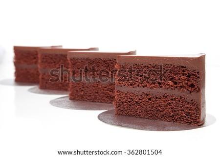 Chocolate fudge cakes sliced on white background isolated - stock photo