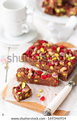 Chocolate Fudge with Glace Cherries, Pistachios and Coconut, copy space for your text, selective focus, shallow dof - stock photo