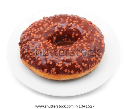 Chocolate glazed donut with cocoa sprinkles isolated on white background.