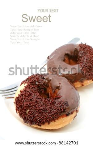 chocolate glazed doughnut with sprinkles isolated on white background - stock photo