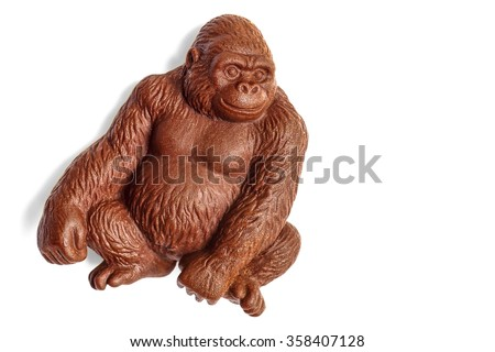 Chocolate gorilla monkey covered with water drops isolated on white with clipping path - stock photo