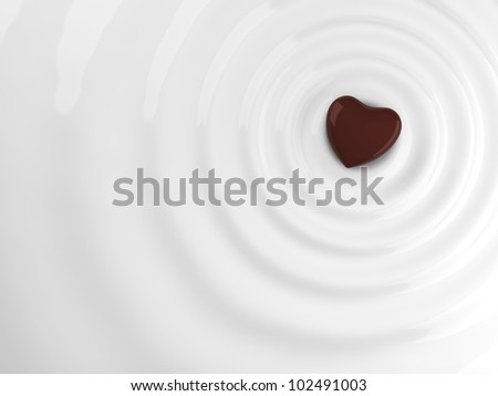 Chocolate heart in hot chocolate wave