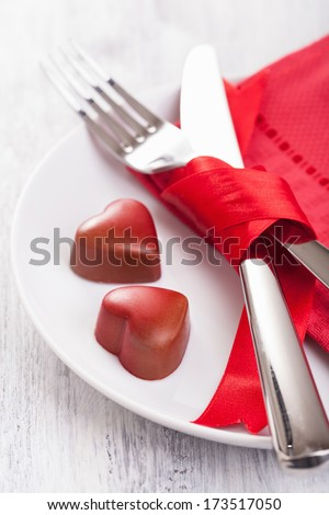 chocolate hearts and silverware on plate for Valentines