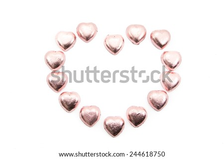 chocolate hearts candies on white