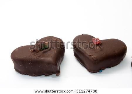 Chocolate hearts on a white background. - stock photo