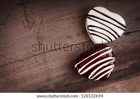 chocolate hearts on wooden background. valentine card concept.