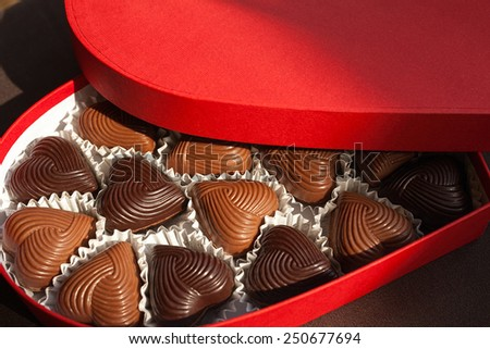 Chocolate Hearts, open box of heart-shaped candy - stock photo