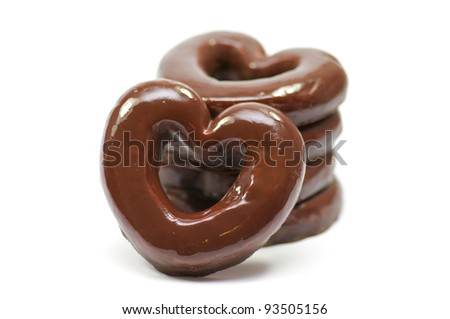 Chocolate hearts-rings in glaze isolated in white background - stock photo