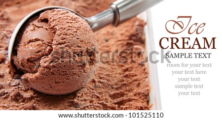 Chocolate ice cream scoop, scooped out of a container with copy space - stock photo