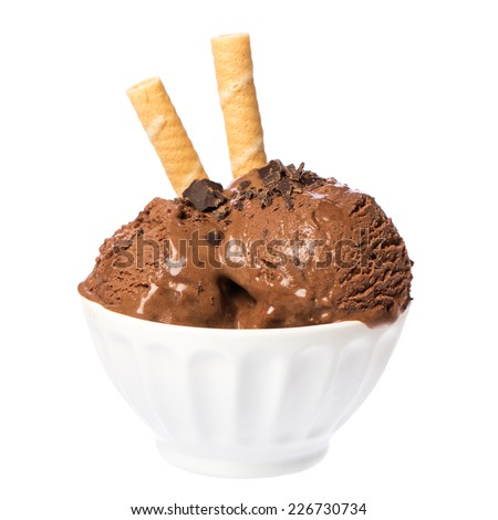 Chocolate ice cream scoops in white bowl with waffles and chocolate pieces on white background - stock photo