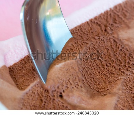 Chocolate Ice Cream Showing Frozen Gelato And Scoop - stock photo