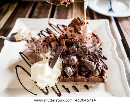 Chocolate ice cream toast served on woodden table.
