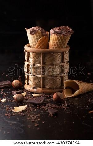 Chocolate ice cream with chocolate chips, hazelnut on a dark background - stock photo