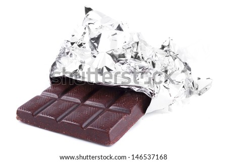 Chocolate in a wrapper on a white background - stock photo