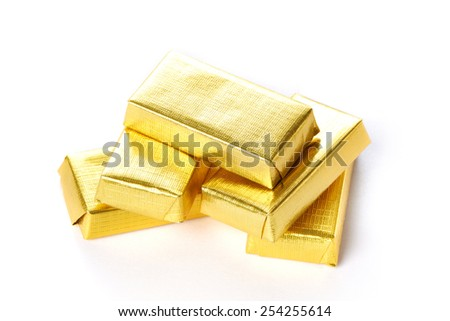 Chocolate in gold wrappers isolated - stock photo