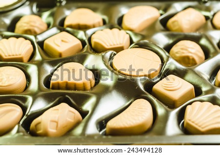 Chocolate in the box. For a gift Valentines Day (chocolate decoration food close up) - stock photo