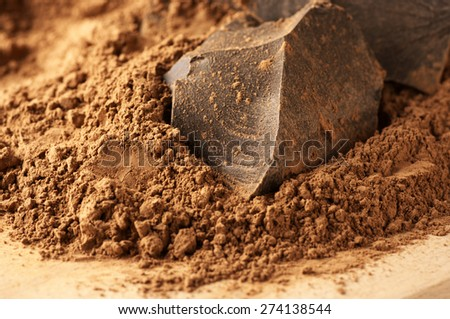 Chocolate ingredients: cocoa solids and cocoa powder close-up. - stock photo
