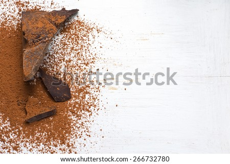 Chocolate ingredients: cocoa solids and cocoa powder. selective focus - stock photo