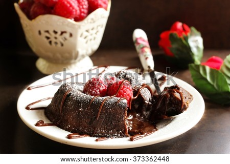 Chocolate lava cake on dark moody background, selective focus / valentines day dessert  - stock photo