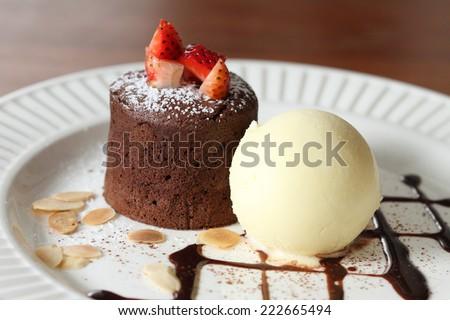 chocolate lava with vanilla ice cream and strawberry - stock photo