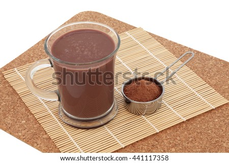Chocolate maca health drink and supplement powder in a metal scoop. Used as an aphrodisiac and also by body builders and in weight training. - stock photo