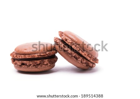Chocolate macaron isolated on white background - stock photo