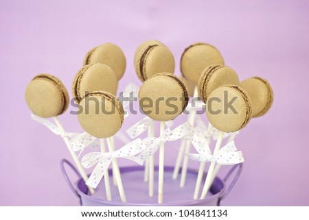 Chocolate macaron pops in a small bucket - stock photo