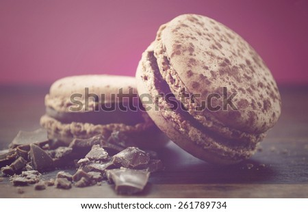 Chocolate Macaroons, with applied retro vintage style filters. - stock photo