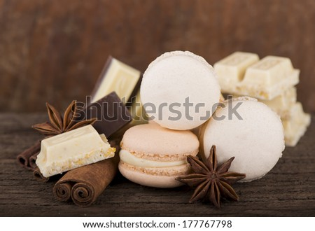 Chocolate macaroons with pieces of white and black chocolate on old ...