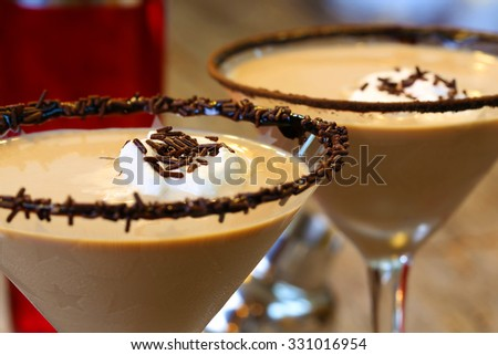 Chocolate martini garnished with chocolate powder on the rim and whip cream and sprinkles - stock photo