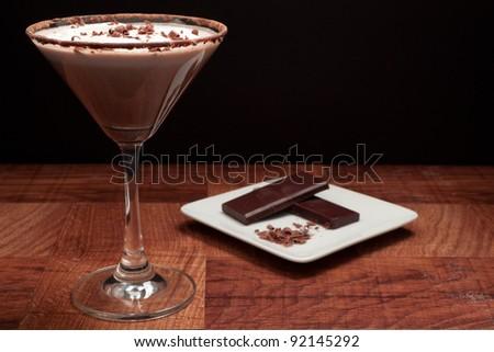 chocolate martini garnished with chocolate power rim and chocolate shavings on cream - stock photo