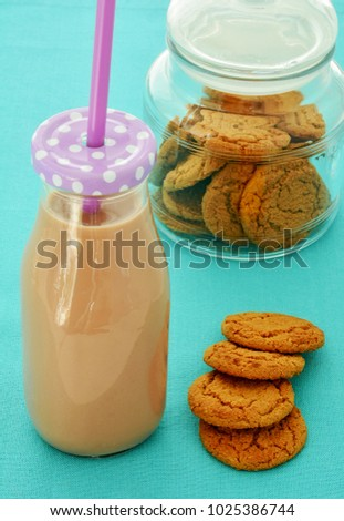 Chocolate milk and ginger cookies in vertical format and shot in natural light
