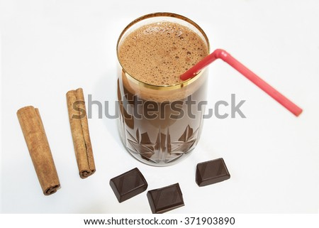 chocolate milk, cinnamon sticks and cloves to the chocolate
