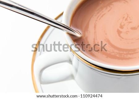 Chocolate milk in white mug, macro shot. - stock photo