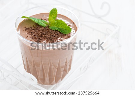 chocolate milkshake in a glass on white background, close-up - stock photo