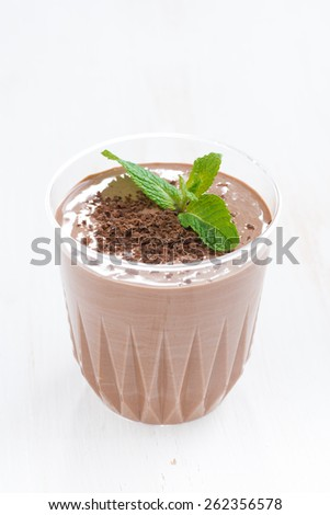 chocolate milkshake in a glass, vertical, close-up - stock photo