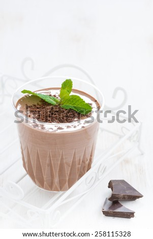 chocolate milkshake with mint in a glass on white background, vertical - stock photo