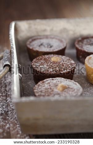 Chocolate  Mini Tartlets in vintage aluminium baking pan, shallow dof - stock photo