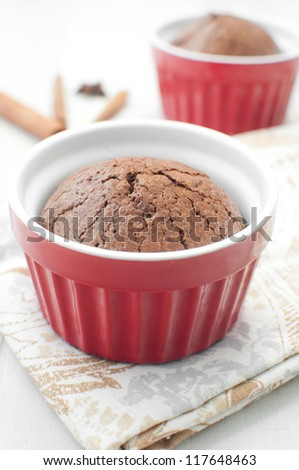 Chocolate molten cake in ramekin vertical