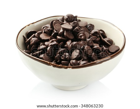 Chocolate morsels in bowl isolated on white