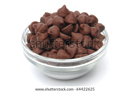 Chocolate morsels in glass bowl on white background - stock photo